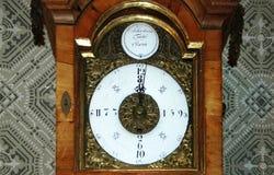Historisk klocka med fyra timmar visartavla Royaltyfri Fotografi