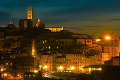 Historisk mitt av Siena på skymning tuscany italy Royaltyfri Foto
