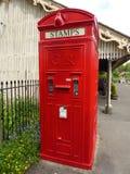 Historisk telefonask och utmatare för portostämpel Royaltyfri Foto