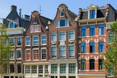 Historiska byggnader i Amsterdam Royaltyfri Foto