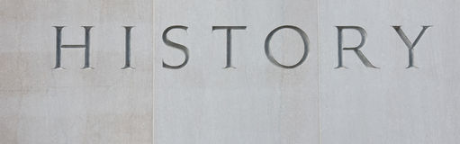 History. Word history carved into stone stock photography