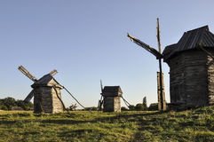 History. Ancient windmill as in old fairytale in the green meadow.  Royalty Free Stock Photos
