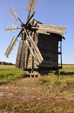 History. Ancient windmill as in old fairytale in the green meadow.  Royalty Free Stock Photography