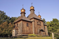 History. Ancient wood Christianity church in the summer meadow Stock Photography