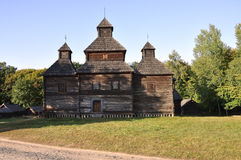 History. Ancient wood Christianity church in the summer meadow.  Stock Image