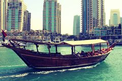 History arriving in future. A wooden boat is arriving at port through time travel Stock Photo