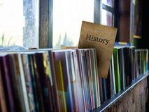 History on book cover on bookshelf, education concept.  Royalty Free Stock Images