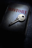 History book. Key on top of an aged book Stock Photo