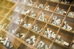 History of book printing. Metallic letters Stock Image