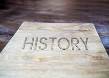 History book on wood paper. And table Stock Images