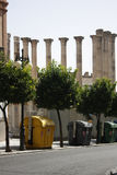 History of civilization. Modern yellow trash on the background of ancient columns in Cordoba Stock Image
