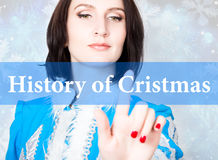 History of cristmas written on virtual screen. concept of celebratory technology in internet and networking. woman in Stock Photography
