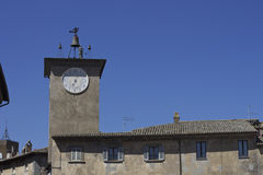 History and culture in Italy. Clock tower in a medieval village in Italy stock photography