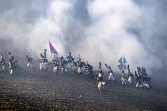 History fans in military costumes marching on the battlefield Royalty Free Stock Photography