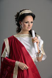 History of fashion design - Neoclassicism, Roman. Neo-Classical woman like goddess in Roman clothing Stock Images