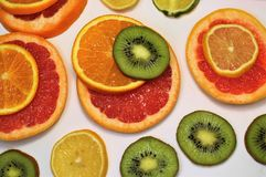 Citrus and kiwi slices on a white background. The view from the top. royalty free stock photos