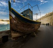 The history of Maltese boats Luzzi. Valletta. Birgu. Kalkara. Bormla. archipelago of Malta. Traditional boats on the coast of the Maltese coast Royalty Free Stock Image