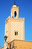History in maroc africa  minaret street lamp. In maroc africa      minaret  and the blue     sky Stock Photography
