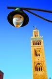 History in maroc africa  street lamp blue     sky. In maroc africa      minaret  and the blue     sky Royalty Free Stock Photo