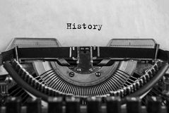 History typed on an vintage typewriter, old paper. close-up royalty free stock images