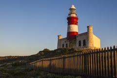 Historyczna przylądka Agulhas latarnia morska przy wschodem słońca Zdjęcia Stock