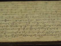 Historyczna ręka pisać na żółtym szorstkim papierze Zdjęcie Royalty Free