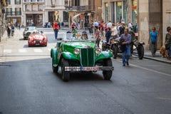Historyczny Mille Miglia 1000 mil samochodowej rasy w Brescia mieście, Włochy Staromodny samochodowy Lancia Augusta, rok: 1934 zdjęcia stock