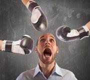 Hit an afraid businessman Stock Image