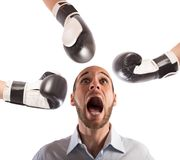Hit an afraid businessman. Many boxing punches hit an afraid businessman Stock Photography