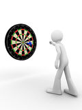 Hit the bull's eye!. Darts player hits the bull's eye Royalty Free Stock Images