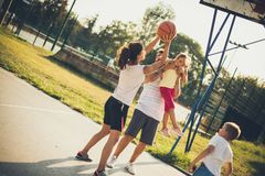 The hit is mine. Family playing basketball stock photo