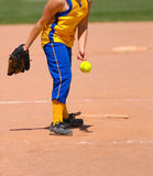 Hit this pitch!. Fastpitch softball pitcher releasing softball towards the hitter at the plate Stock Photo