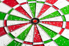 Hit red & green bullseye dart board target game. Old red & green bullseye dart board target game Royalty Free Stock Photo