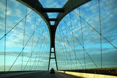 Hit the road. Car travelling the road and crossing a bridge in Denmark Stock Photography