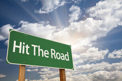 Hit The Road Green Road Sign. With Dramatic Clouds and Sky Royalty Free Stock Images