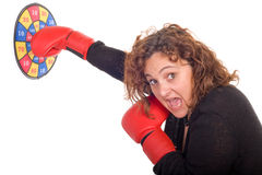 Hit the target. Business woman hitting the target with reg boxing gloves royalty free stock photography