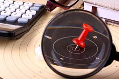 Hit the target with magnifying glass, target with red pin Stock Photos