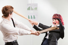 Hit war woman against man in the workplace Stock Images