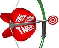 Hit Your Target - Bow and Arrow Aimed at Bulls Eye Royalty Free Stock Photography