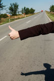 Hitch hike 02. Hitch hike on a road Stock Photography