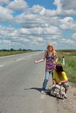 Hitch hiking couple Royalty Free Stock Photos