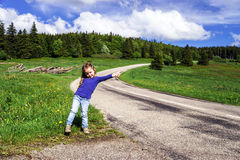 Hitch-hiking by cute little  girl Stock Images