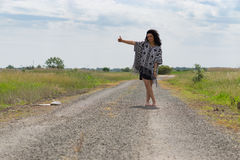 Hitch-hiking free young woman Stock Photography