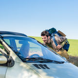 Hitch-hiking getting lift young woman in car Stock Photo