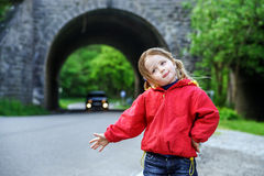 Hitch-hiking by little girl Royalty Free Stock Photography