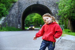 Hitch-hiking by little girl Stock Image