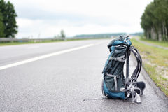 HITCH HIKING. At the road in cloudy day Stock Photography