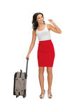 Hitch-hiking woman with suitcase. Bright picture of hitch-hiking woman with suitcase Stock Photo