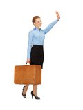 Hitch-hiking woman with suitcase Stock Photography