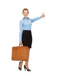 Hitch-hiking woman with suitcase. Bright picture of hitch-hiking woman with suitcase Stock Photography
